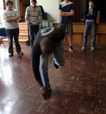 Camilo Ballumbrosio shows students an especially difficult tap dance move.