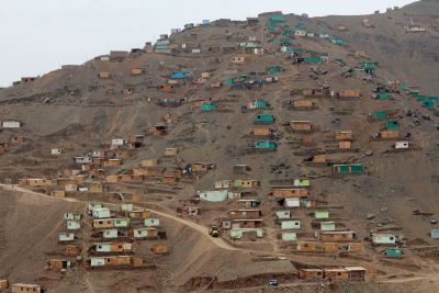 A sprawling new neighborhood on a rocky hillside in Puente Piedra. These small homes lack running water, gas and electricity.