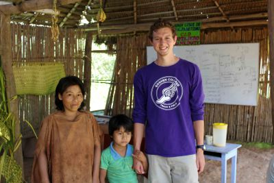 Derek with his host  mother and brother. His host father was out  hunting the day we visited San Miguel.