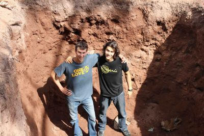 Lucas and Joel inside a huge septic pit they helped dig.