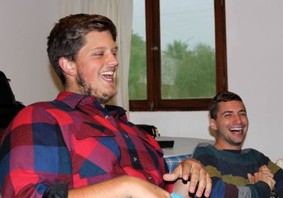 Michael, left, laughs about a health problem during his time on service. Stefan finds the story to be hilarious.