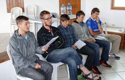 Stefan, Matt, Tim, Joel and Derek William sing during worship.