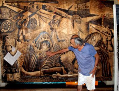 Delfin shows the group a huge wood carving on terror during the times of the Shining Path.