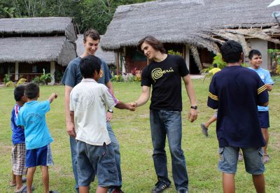 Lucas and Joel speak with some boys.
