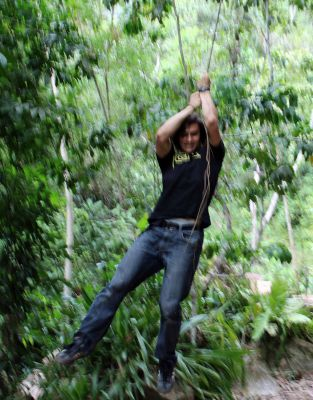 Lucas swings from a vine, but without a Tarzan yell.