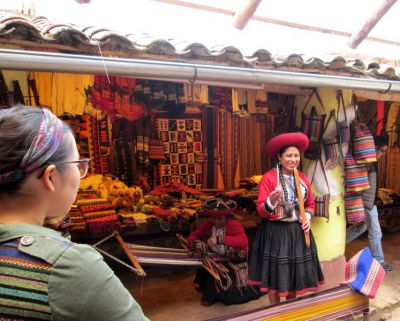 Shina listens to a weaver from Chinchero talk about the creative process that goes into making textiles.