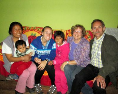 Duane and Karen pose with Danielle and members of her host family.