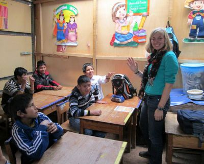 Abby talks with students in her classroom at San Martin, a public school that serves deaf children in Cusco.