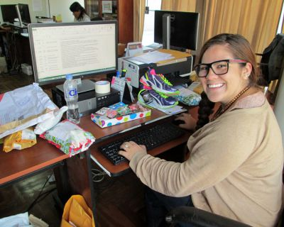 Frances at her desk in the Cusco office of World Vision, surrounded by gifts sponsors have sent to local children.
