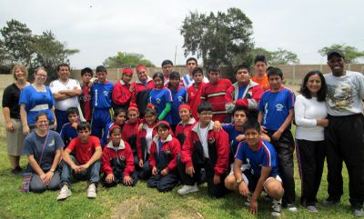 Students from the Harvest School for the Deaf take a break from game playing to pose for a group photo.
