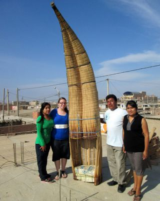 Jessica on the roof of her house with her Santa Rosa host family by her dad's fishing boat.