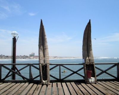 A view of the shore and a boater from the pier in Pimentel.