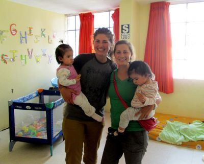 Elizabeth poses with fellow SSTer, Mariah, and twin girls who live at the Casa Luz orphanage in Ayacucho.