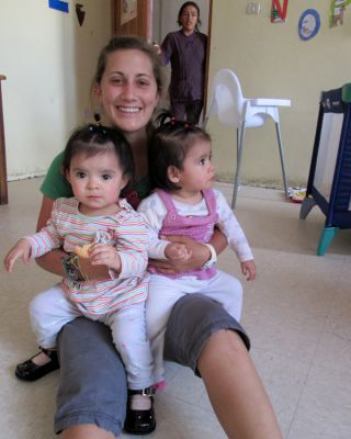 Mariah with twin girls, just over a year old, at Hogar Casa Luz orphanage.