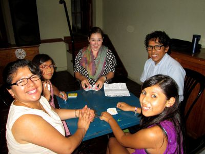 Elizabeth and her host family play a round of Dutch Blitz.