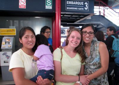 Courtney's host family says goodbye as she leaves, via bus, for her service location.