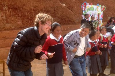 Christian and Willy play silly circle games with the children of Fe y Alegria.