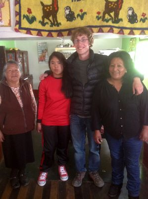 Christian with his host grandmother, sister and mother.