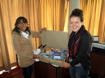 Lea and Noemi Callasi, a donor supervisor at World Vision, with a box of gifts that arrived for a sponsored child in the Cusco area.