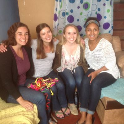 Abbie, Morgan, Kate and Asia pose for a photo in Morgan's living room.