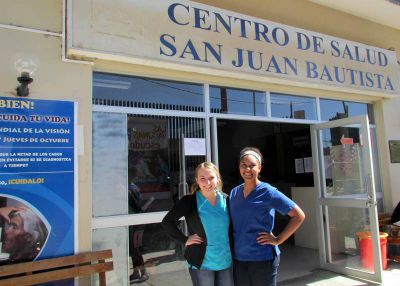 Kate and Asia in front the Centro de Salud in Ayacucho.