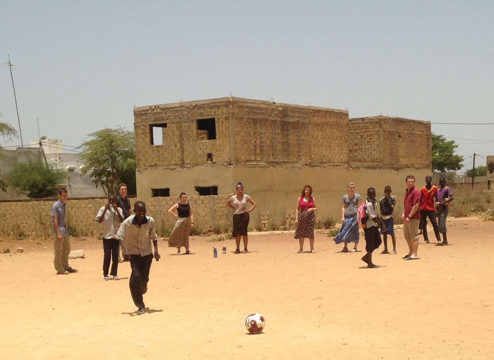 Futbol in Senegal with students and children creates a unique college program.