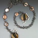 """Stone.  Enamel, jasper, pearls, copper. 42 x 1 x 1.25"""""""