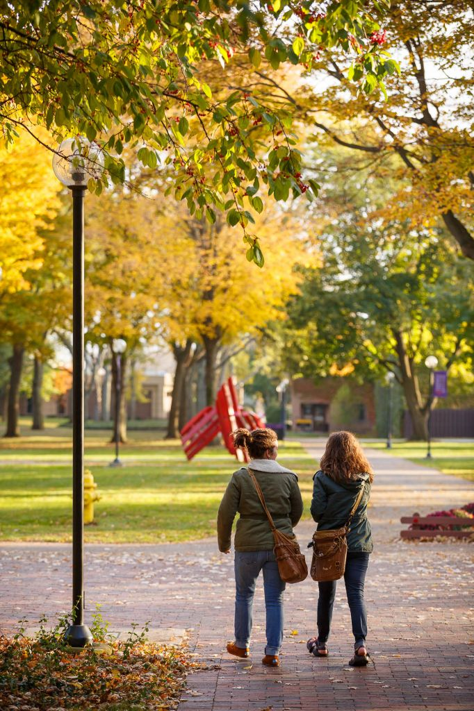 Two students walking on Goshen's college campus