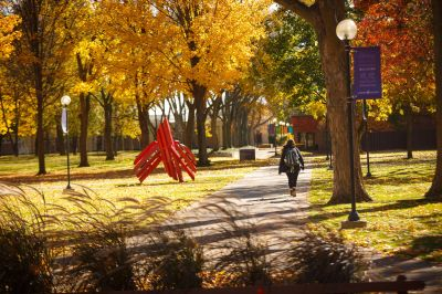 College student walking through Goshen's beautiful campus in Northern Indiana.