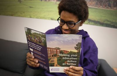 Student reading through Goshen's resource on our financial aid options