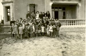 A group photo from the children's home in Canet Plage, located on the Mediterranean Sea. The children's center became a safe haven for the children of Spanish refugees as well as for Jewish children, many of whom were smuggled out of the nearby internment camp of Rivesaltes.