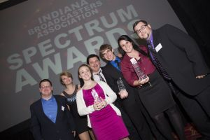 "(L-R) Tony Miller, Ashley Davenport, Danielle Kerschhackl, WGCS General Manager Jason Samuel, Andrew Witkowski, Kelsey Morris and Jimmy Cassoday are pictured after winning the ""Station of the Year"" award at the 26th annual IBA Spectrum Awards. (Photo by Kyle Hufford)"