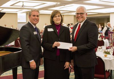 (L-R) Jim Caskey, vice president for institutional advancement, with Theresa Noll, who presented a check on behalf of the estate of the Norman family, and Goshen College President Jim Brenneman. (Photo by Alia Munley/Goshen College)