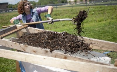Natasha Weisenbeck '13, a senior public relations graduate from Clifton, Ill., was a student volunteer on Goshen College's composting team.