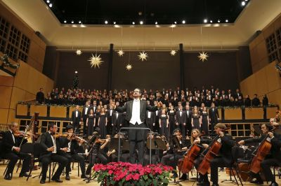 "Scott Hochstetler, associate professor of music, leads the audience in a traditional Christmas carol during the 2014 ""A Festival of Carols"" performance at Goshen College. (Photo by Brian Yoder Schlabach)"