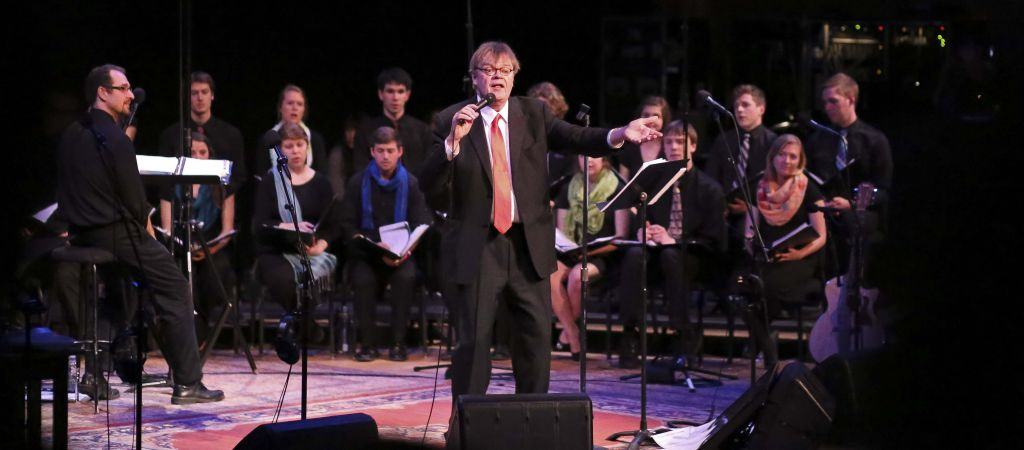 Garrison Keillor leads the audience in a hymn during the May 2 live broadcast of A Prairie Home Companion at Goshen College. (Photo by Brian Yoder Schlabach)