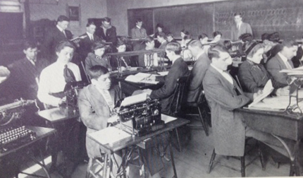 Miller teaches a business class at GC in 1915