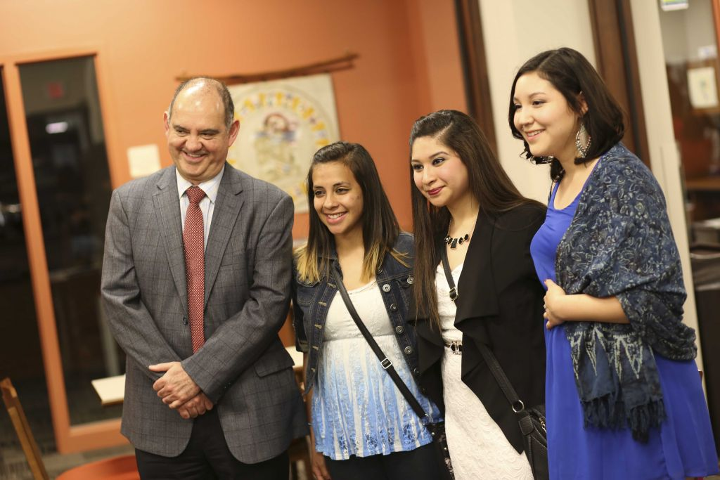 Goshen College students pose for a photo with Consul Jorge Sanchez of the Mexican Consulate in Indianapolis in May 2015.