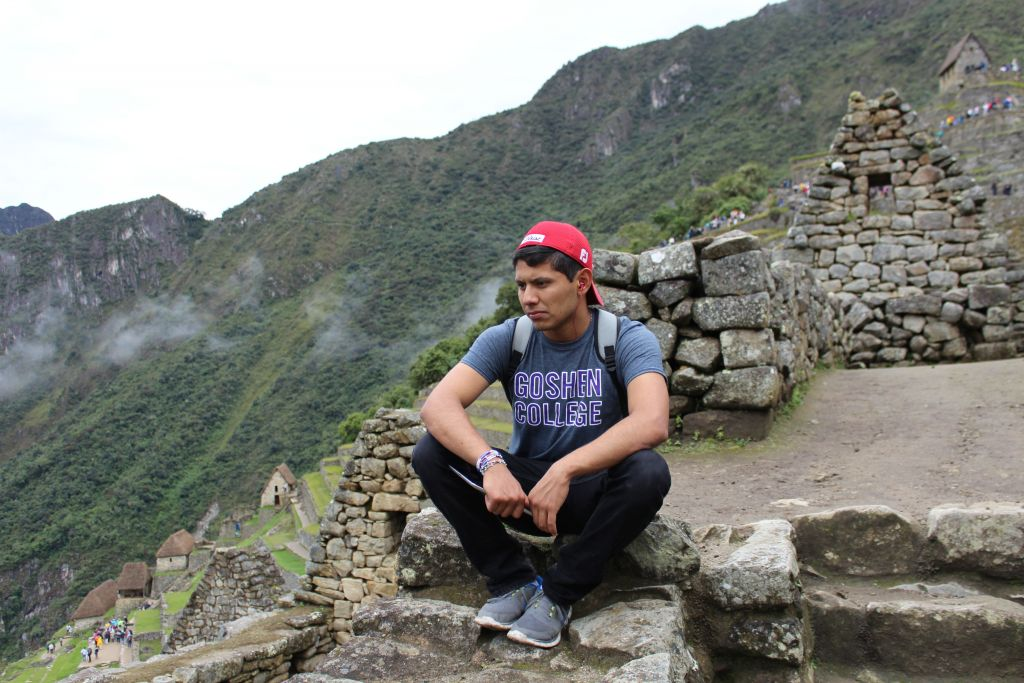 Alejandro Genis observes ancient ruins during his SST experience in Peru