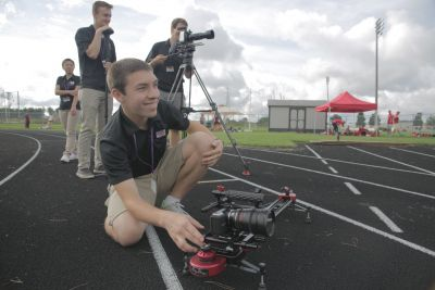 Jake Smucker, a 2015 graduate and FiveCore Media assistant producer, works the camera during a shoot.