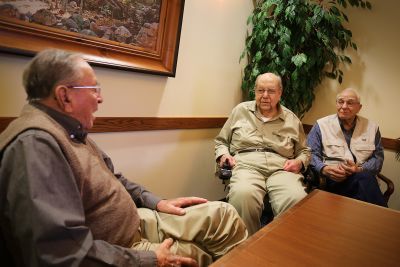 Gordon Yoder, associate director emeritus of college relations for Goshen College (left), visits with Milo Albrecht (center) and Herb Roth (right) at the Apostolic Christian Restmor in Morton, Illinois, in November, 2014.