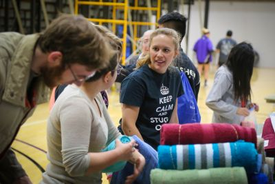 Brianne Brenneman helps pack MCC relief kits for Syrian Refugees during a basketball halftime event, sponsored by GC's Service Club.