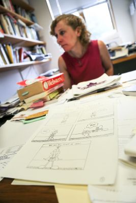 Jessica Baldanzi, associate professor of English, looks over drafts of comics created by students.