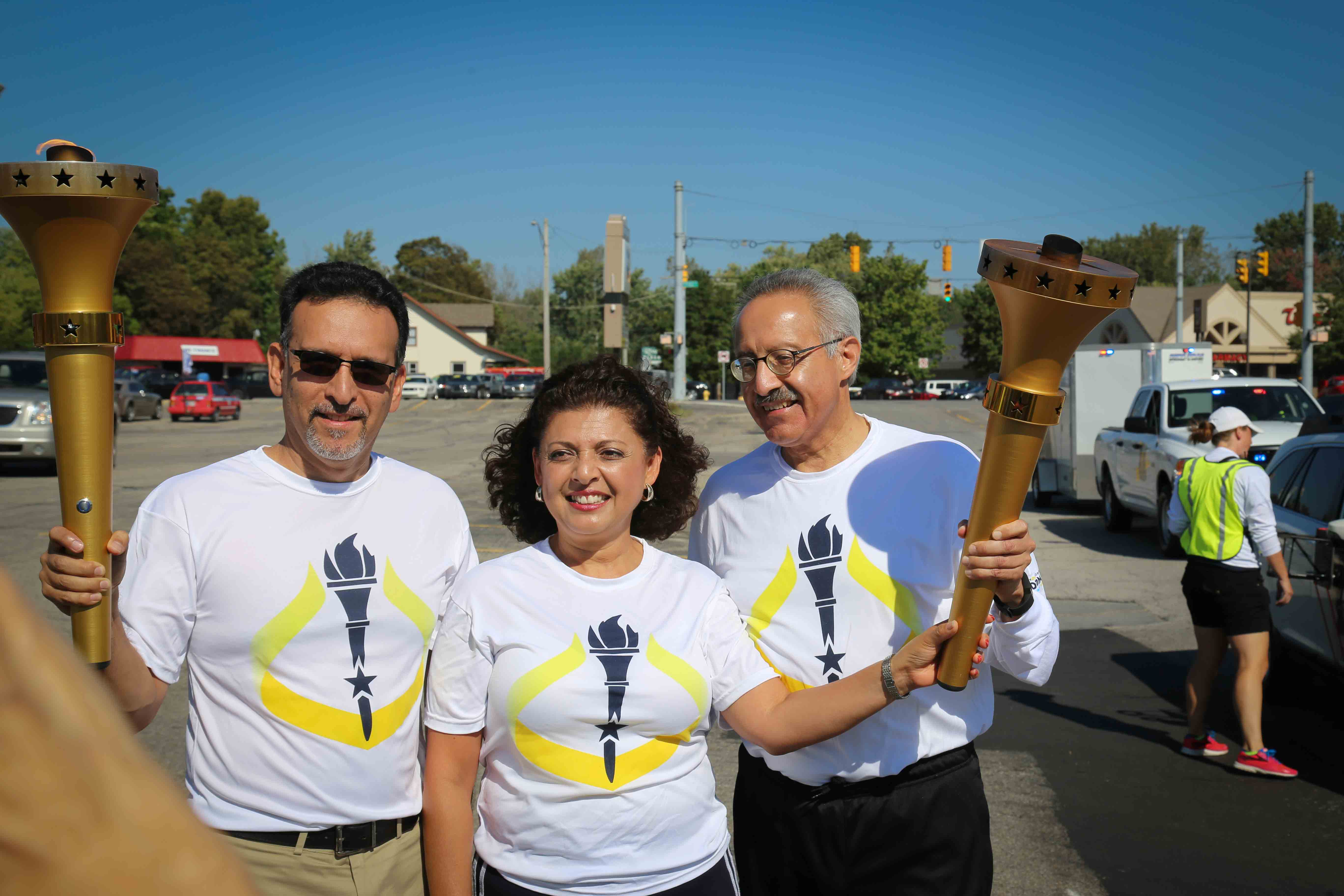 From left: Gilberto Pérez Jr., Rocio Diaz and Richard Aguirre were among the 40 torch bearers on Oct. 4, 2016.