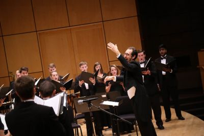 Dr. Scott Hochstetler directs the Goshen College Chamber Choir during the Homecoming Music Gala on Oct. 8, 2016.