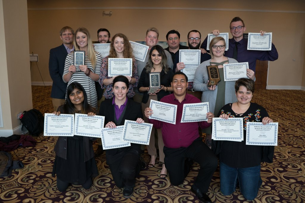 Group of students with awards