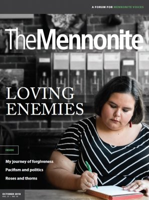 Cover of The Mennonite with a picture of a woman writing in a journal in the right bottom corner.