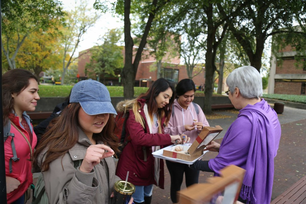 President Stoltzfus passing out donuts to students outside