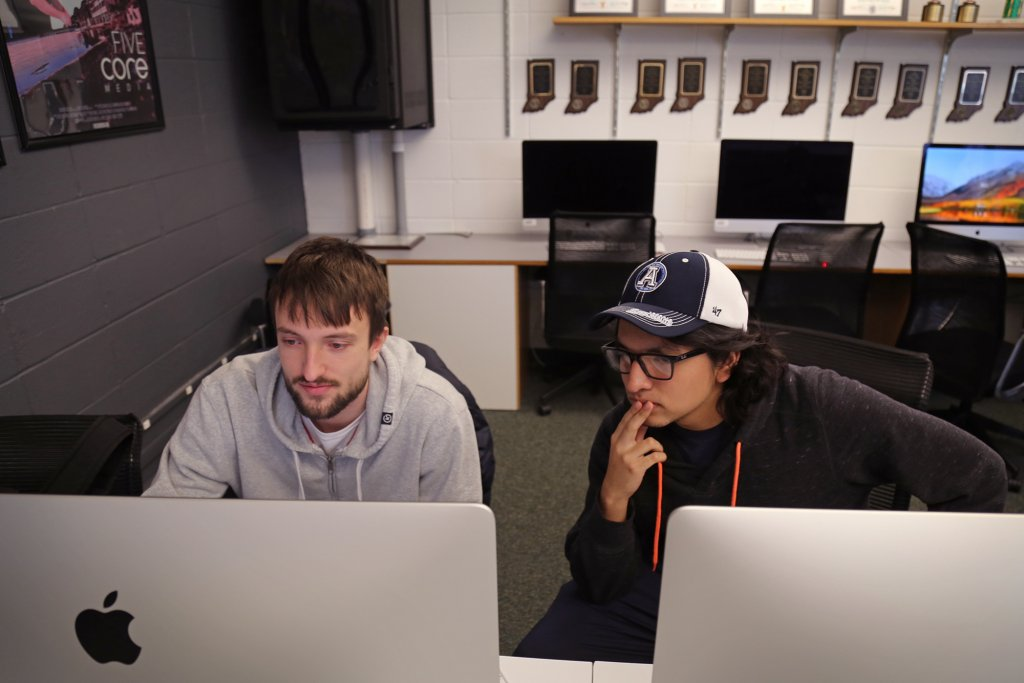 Two students working on the computers