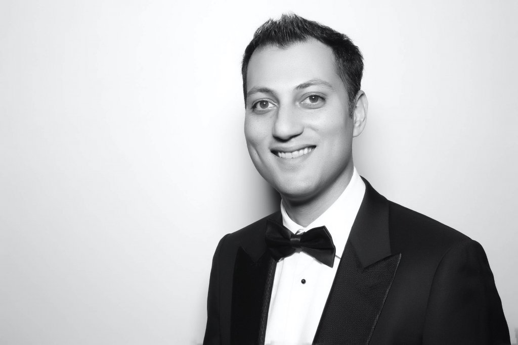Head shot of man dressed in suit and tie